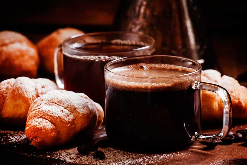 2 glass cups of black coffee
